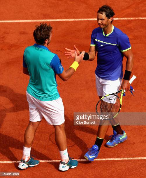 Runner up, Stan Wawrinka of Switzerland congratulates, Rafael Nadal of Spain on victory in the mens singles final match on day fifteen of the 2017...