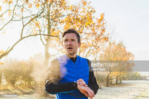 runner using smart watch - wearable computer stock pictures, royalty-free photos & images