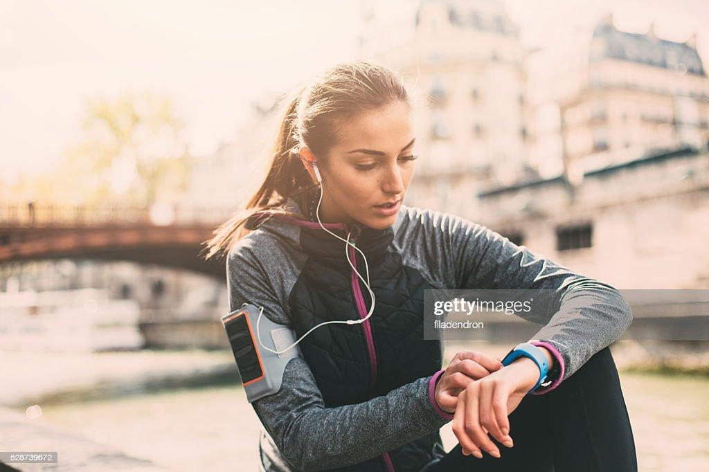 Runner using smart watch : Stock Photo