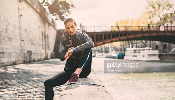runner using smart watch - smart watch stock pictures, royalty-free photos & images