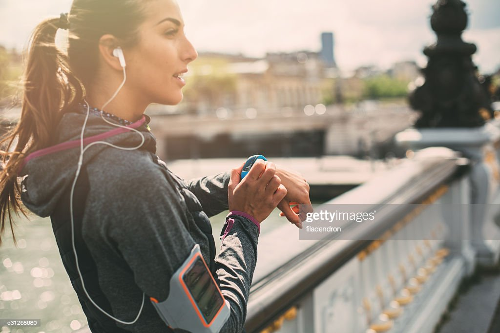Runner using smart watch : Stock Photo