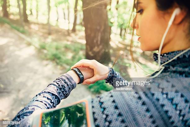runner using smart watch - checking sports stock pictures, royalty-free photos & images