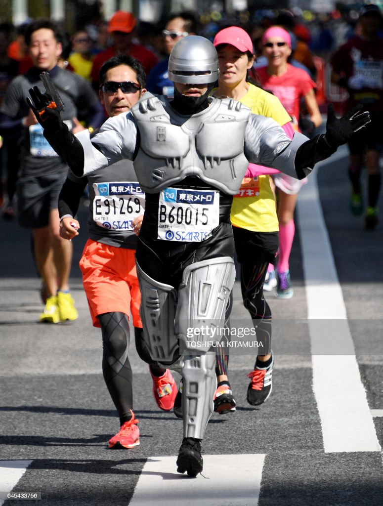 A runner wearing a costume of 'Robo Cop' runs past the Ginza shopping district during the Tokyo Marathon 2017 in Tokyo on February 26, 2017. /