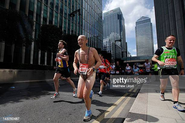 A runner wearing a mankini passes through the Canary Wharf section of the Virgin London Marathon 2012 on April 22 2012 in London England
