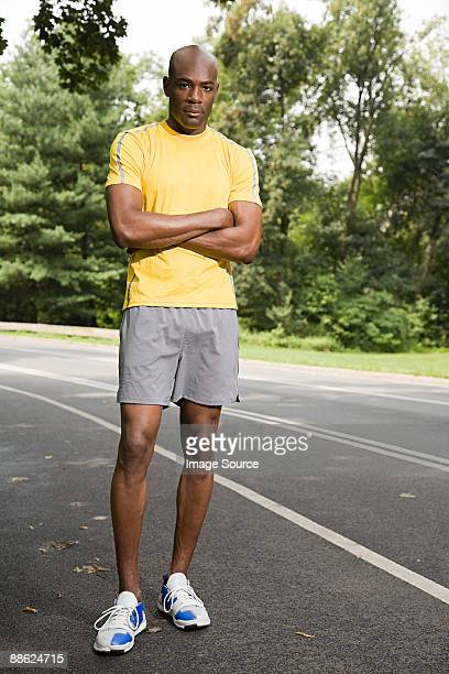 runner with crossed arms - black shorts stock pictures, royalty-free photos & images