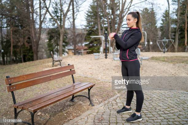 runner woman stretching - one young woman only stock pictures, royalty-free photos & images