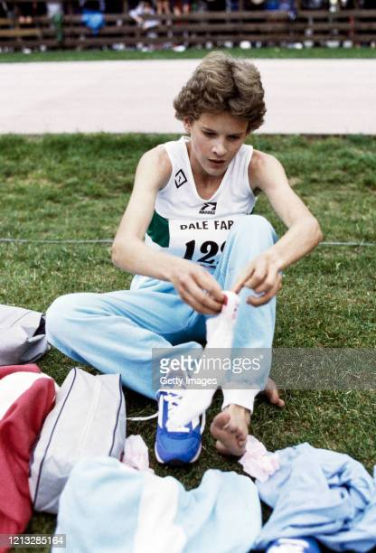 Runner Zola Budd puts her socks on after a race in the United Kingdom circa 1985 .