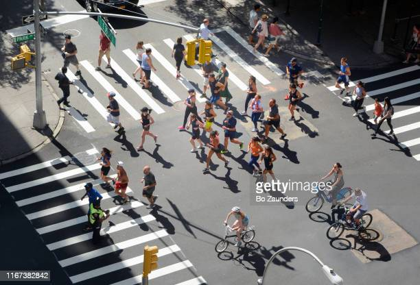runners and bikers at summer streets, car-free festival on three weekends in august, in manhattan, nyc. - bo zaunders stock pictures, royalty-free photos & images
