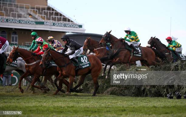 Runners and riders clear The Chair during the Randox Grand National Handicap Chase, on Grand National Day of the 2021 Randox Health Grand National...