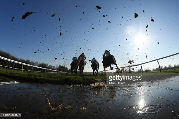 Runners and riders clear the water jump during the Sileby Steeple Chase at Leicester racecourse on February 26 2019 in Leicester England