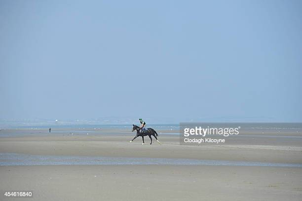 Runners and Riders during the Laytown Races race meet on the beach in Laytown Co Meath on September 4 2014 in Dublin Ireland