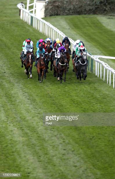 Runners and riders during The Weatherbys nhstallions.co.uk Standard Open NH Flat Race during Grand National Day of the 2021 Randox Health Grand...