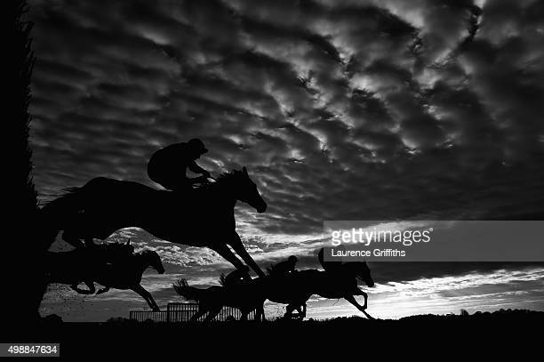 Runners and Riders in action as the sun goes down during The Last Day racingukcom/freetrial Handicap Steeple Chase at Wetherby Racecourse on November...