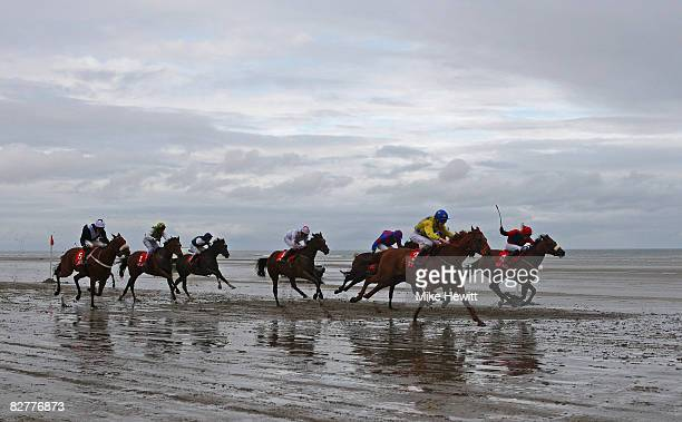 Runners and riders in the fifth race the O'Neills Sports Handicap charge down the beach at the Laytown beach race track on September 11 2008 in...