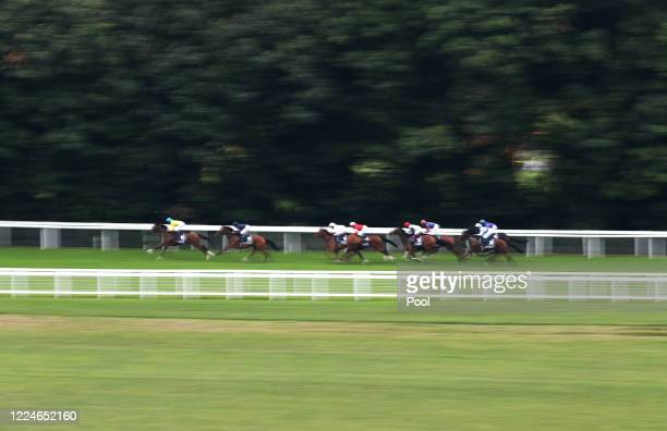 Runners and riders in the Investec Oaks at Epsom Racecourse on July 04 2020 in Epsom England The famous race meeting will be held behind closed doors...