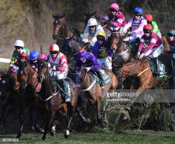 Runners and riders jump Canal Turn on the first time of asking during the 2018 Randox Health Grand National at Aintree Racecourse on April 14 2018 in...