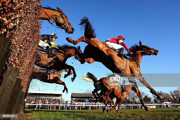 Runners and Riders jump in front of the Grandstand during the totesportcom Peterborough Chase at Huntingdon Racecourse on December 11 2008 in...
