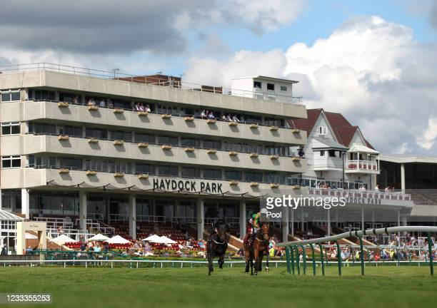 Runners and riders pass the grandstand during the Join Racing TV Now Handicap at Haydock Park Racecourse on June 9, 2021 Newton-le-Willows, England.