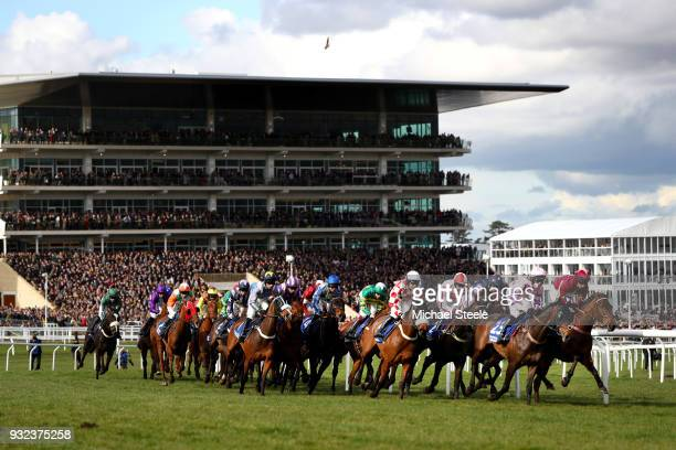 Runners and Riders pass the Main Stand during the Pertemps Network Final Handicap Hurdle at Cheltenham Racecourse on March 15, 2018 in Cheltenham,...