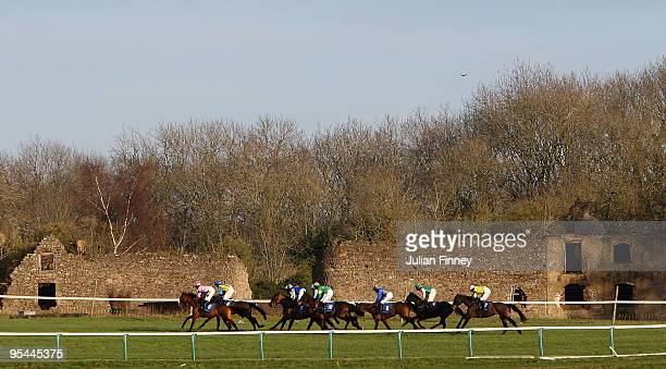 Runners and riders race down the back straight in The Coralcouk Handicap Steeple Chase run during Chepstow Races on December 28 2009 in Chepstow Wales