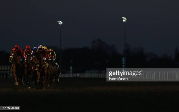 Runners and riders race in the the 32Red on the app store handicap stakes at Kempton Park on November 22 2017 in Sunbury England
