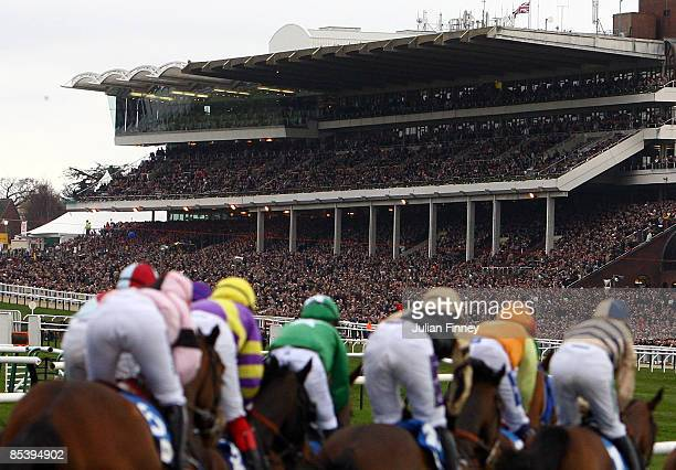 Runners and riders race towards the finish in The Pertemps Final hurdle run during day three of the Cheltenham Festival at Cheltenham racecourse on...