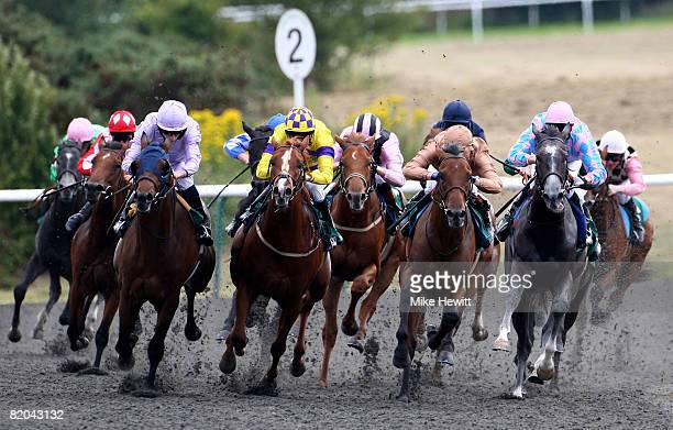 Runners and riders turn in to the home straight with eventual winner High Alert and jockey Ryan Moore well positioned front left during the European...