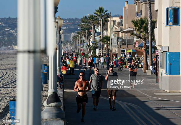 Runners and walkers on the boardwalk along Mission Beach in San Diego CA on Monday October 27 2014