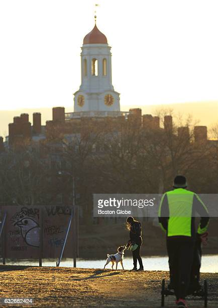 Runners and walkers puff through the brisk morning air along the Charles River near Harvard Square in Cambridge MA on Feb 22 2016