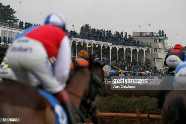 Runners approach a fence as racegoers look on at Ludlow racecourse on February 8 2017 in Ludlow England
