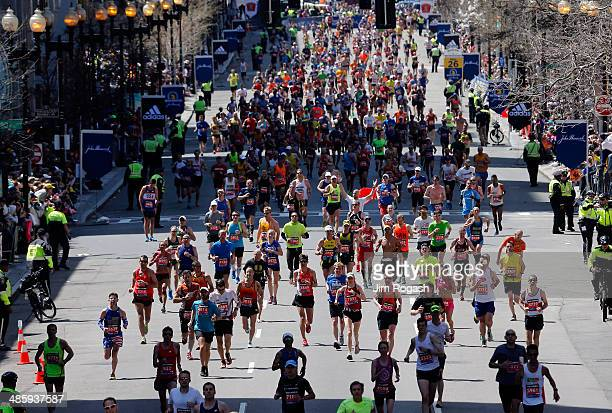 Runners approach the finish line of the 118th Boston Marathon on April 21, 2014 in Boston, Massachusetts.