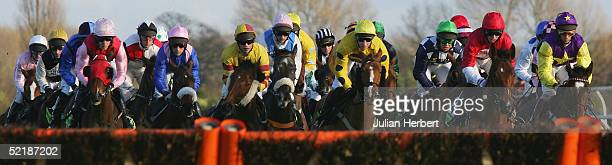 Runners approach the first flight during The totesport Trophy Hurdle Race run at Newbury Racecourse on February 12 2005 in Newbury England The race...