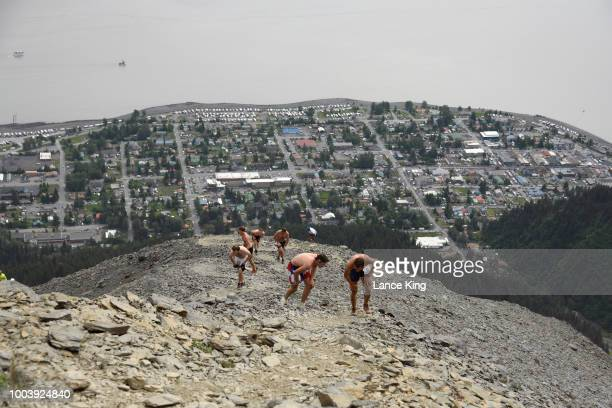 Runners approach the top of Mount Marathon during the Men's Division of the 91st Running of the Mount Marathon Race on July 4 2018 in Seward Alaska...