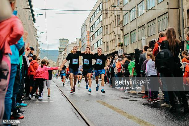 runners are celebrating the finish - half_marathon stock pictures, royalty-free photos & images