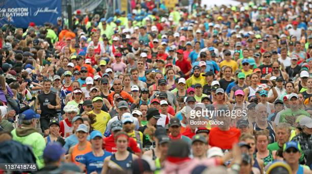 Runners are clustered together at the start of the Boston Marathon in Hopkinton MA on April 15 2019