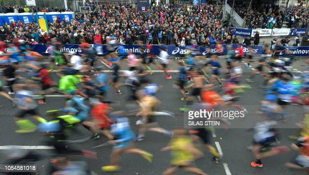 TOPSHOT Runners are pictured during the start of the Frankfurt Marathon on October 28 2018 The Frankfurt running event is the oldest city marathon in...