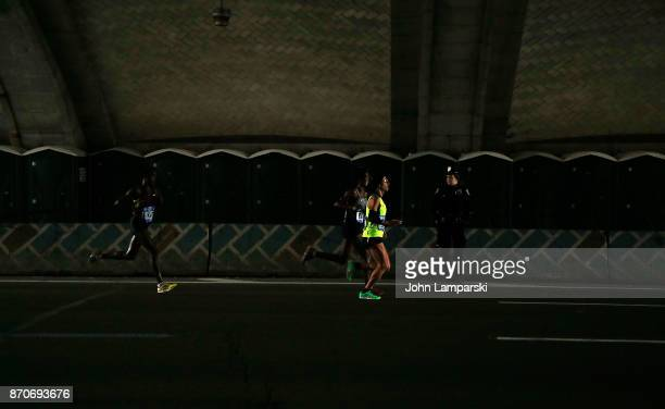 Runners are seen at mile 17 during the 2017 TCS New York City Marathon on November 5 2017 in New York City