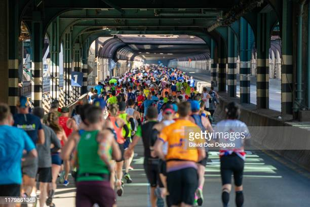 Runners are seen crossing the 59th street bridge during the 2019 TCS New York City Marathon on November 3, 2019 in New York City.