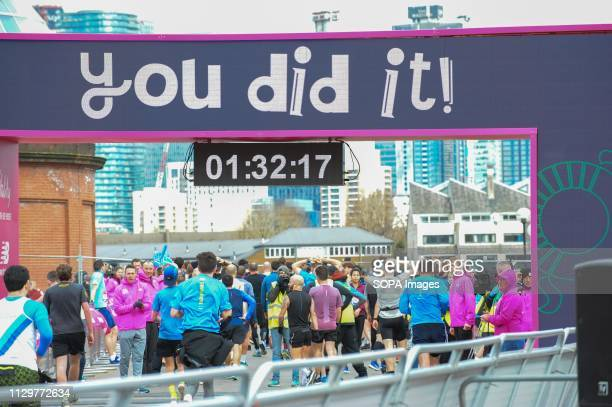 Runners are seen crossing the finishing line during The Vitality Big Half, which has returned for a festival of running and culture to the heart of...