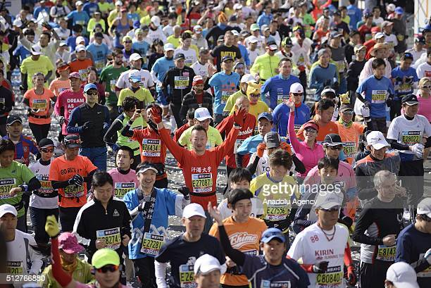 Runners are seen during the start of the Tokyo Marathon on February 28 2016 in Tokyo Japan Thousands people take part in the Tokyo Marathon 2016 also...