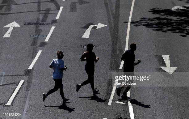 Runners are seen out jogging on April 26 2020 in London England The 40th London Marathon was due to take place today with thousands of runners due to...