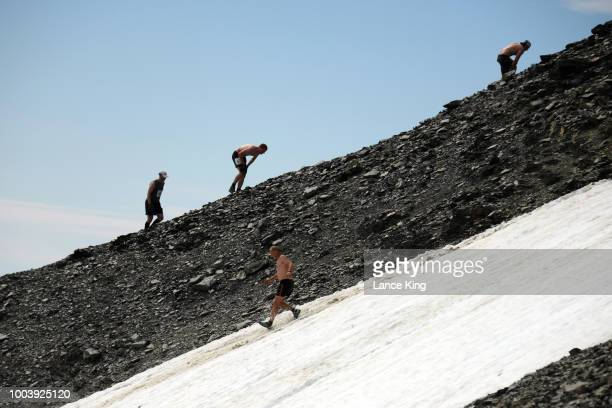 Runners ascend and descend Mount Marathon during the Men's Division of the 91st Running of the Mount Marathon Race on July 4 2018 in Seward Alaska...