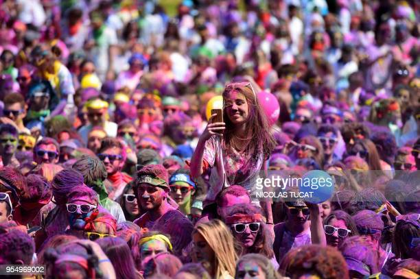 TOPSHOT Runners attend a DJ concert after finishing the Burdi Colors race on May 5 2018 in Pessac southwestern France The Burdi Colors is a 5 km race...