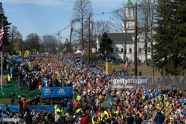 Runners begin the race in Hopkinton at the start of the 118th Boston Marathon on Monday April 21 2014