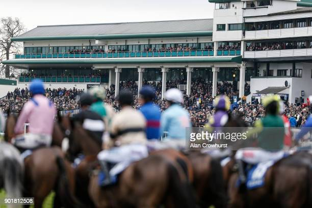 Runners begin to form a line in front of the grandstands for the start of The Coral Welsh Grand National Handicap Steeple Chase at Chepstow...