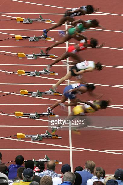 Runners blast off the starting blocks of the women's 100 meter sprint at the IAAF World Championships 2005 in Helsinki Finland August 7 2005