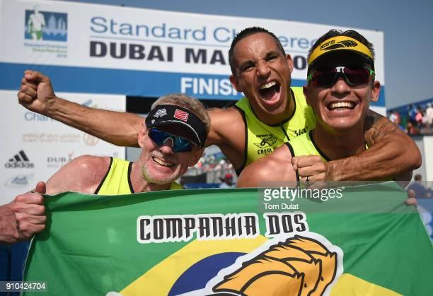 Runners celebrate finishing the Standard Chartered Dubai Marathon on January 26 2018 in Dubai United Arab Emirates