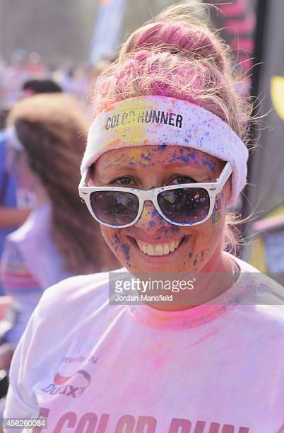 Runners celebrate in The Colour Festival Area after the Color Run presented by Dulux known as the happiest 5km on the planet at Queen Elizabeth...