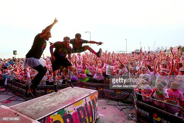 Runners celebrate in the Festival Area after The Color Run on October 10 2015 in Brighton England The Color Run took place at Brighton's Madeira...