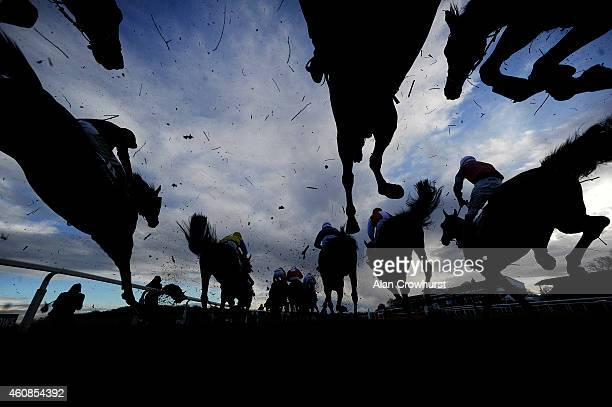 Runners clear a fence in The Coral Welsh Grand National at Chepstow racecourse on December 27 2014 in Chepstow Wales